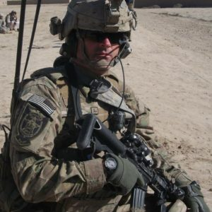 active duty deployed soldier in full gear